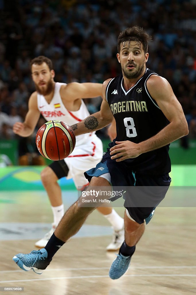 Nicolas Laprovittola of Argentina moves the ball past Sergio Rodriguez of Spain during a Men's Basketball Preliminary Round Group B game between...