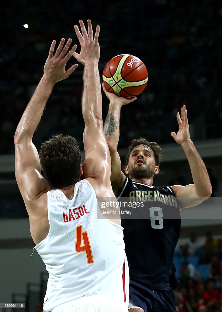 Nicolas Laprovittola of Argentina shoots against Pau Gasol of Spain during a Men's Basketball Preliminary Round Group B game between Spain and...