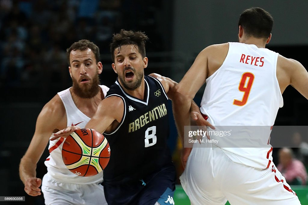 Nicolas Laprovittola of Argentina works against Felipe Reyes and Sergio Rodriguez of Spain during a Men's Basketball Preliminary Round Group B game...