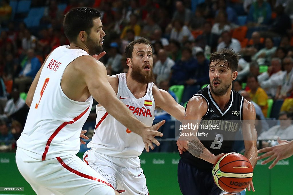 Nicolas Laprovittola of Argentina works against Sergio Rodriguez and Felipe Reyes of Spain during a Men's Basketball Preliminary Round Group B game...