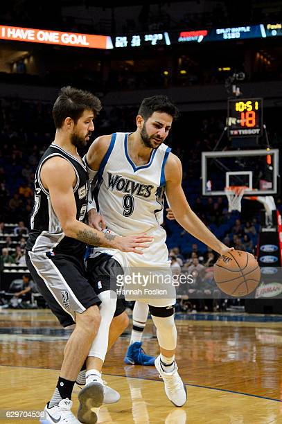 Nicolas Laprovittola of the San Antonio Spurs defends against Ricky Rubio of the Minnesota Timberwolves during the game on December 6 2016 at Target...