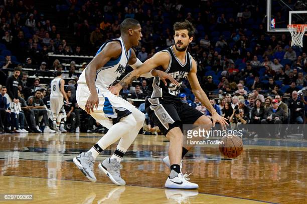 Nicolas Laprovittola of the San Antonio Spurs dribbles the ball against Kris Dunn of the Minnesota Timberwolves during the game on December 6 2016 at...
