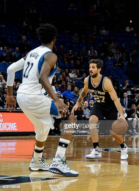 Nicolas Laprovittola of the San Antonio Spurs dribbles the ball against Andrew Wiggins of the Minnesota Timberwolves during the game on December 6...