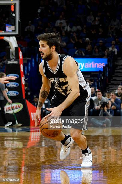 Nicolas Laprovittola of the San Antonio Spurs dribbles the ball against the Minnesota Timberwolves during the game on December 6 2016 at Target...