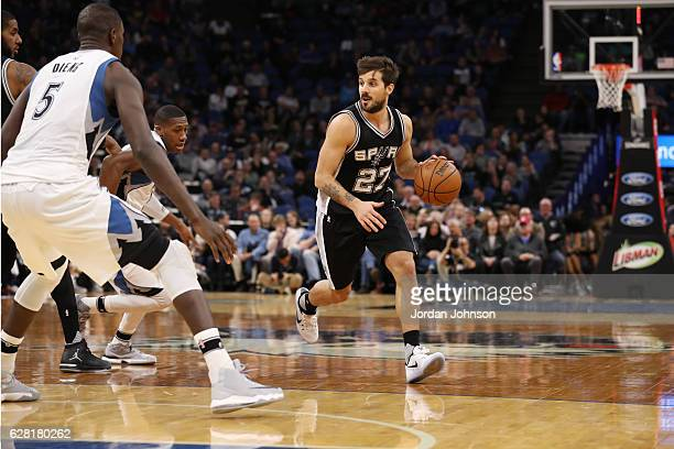 Nicolas Laprovittola of the San Antonio Spurs drives to the basket against the Minnesota Timberwolves during the game on December 6 2016 at Target...