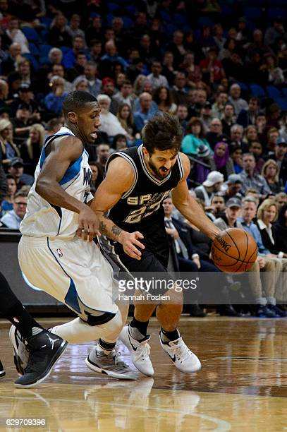Nicolas Laprovittola of the San Antonio Spurs drives to the basket against Kris Dunn of the Minnesota Timberwolves during the game on December 6 2016...