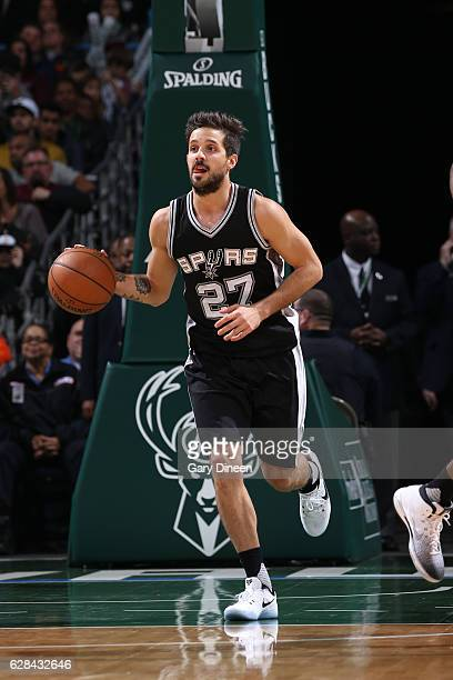 Nicolas Laprovittola of the San Antonio Spurs handles the ball against the Milwaukee Bucks on December 5 2016 at the BMO Harris Bradley Center in...