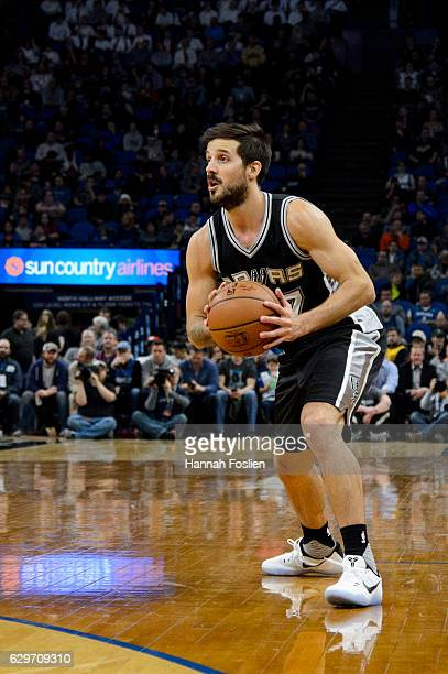 Nicolas Laprovittola of the San Antonio Spurs holds onto the ball against the Minnesota Timberwolves during the game on December 6 2016 at Target...