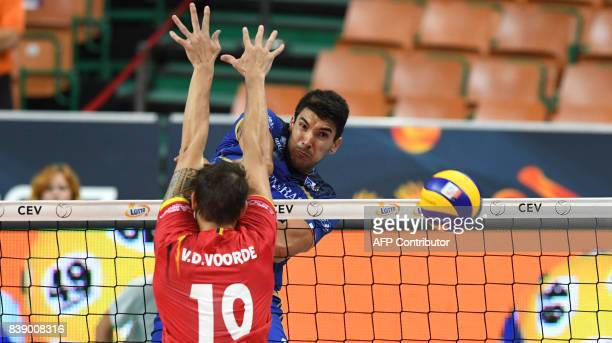 Nicolas le Goff of France spikes against Simon van de Voorde of Belgium during the group D match between France and Belgium of the 2017 CEV Men's...