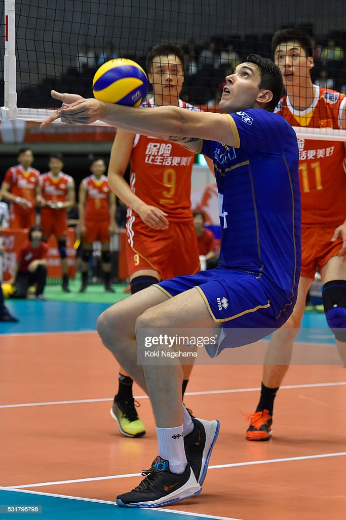Nicolas Le Goff #14 of France tosses the ball during the Men's World Olympic Qualification game between China and France at Tokyo Metropolitan Gymnasium on May 28, 2016 in Tokyo, Japan.
