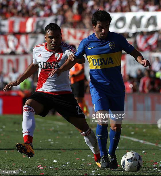 Nicolas Lodeiro of Boca Juniors and Gabriel Mercado of River Plate fight for the ball during a match between River Plate and Boca Juniors as part of...
