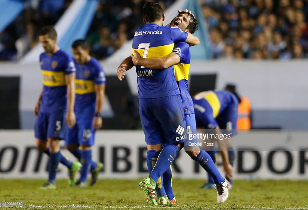 Nicolas Lodeiro of Boca Juniors celebrates with teammate Cristian Pavon after scoring the opening goal during a match between Racing and Boca Juniors...