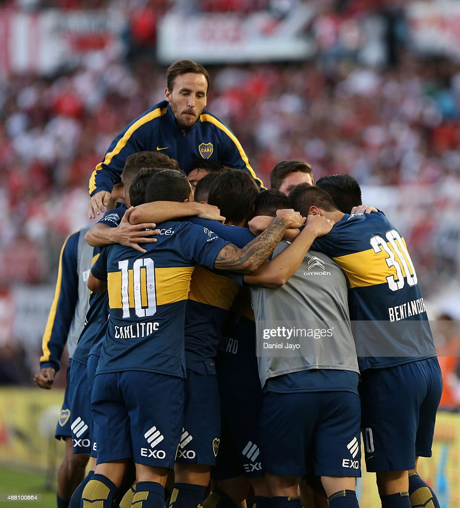 Nicolas Lodeiro of Boca Juniors celebrates with teammates after scoring the opening goal during a match between River Plate and Boca Juniors as part...