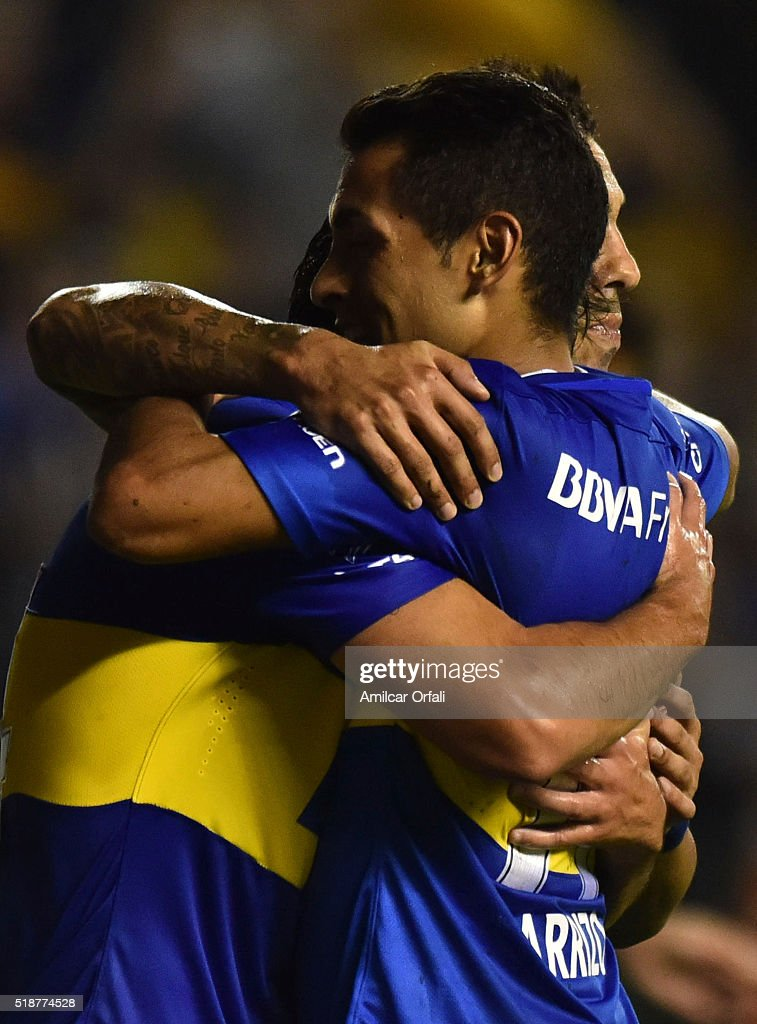 Nicolas Lodeiro of Boca Juniors celebrates with teammates Carlos Tevez and Federico Carrizo after scoring the third goal his team during a match...