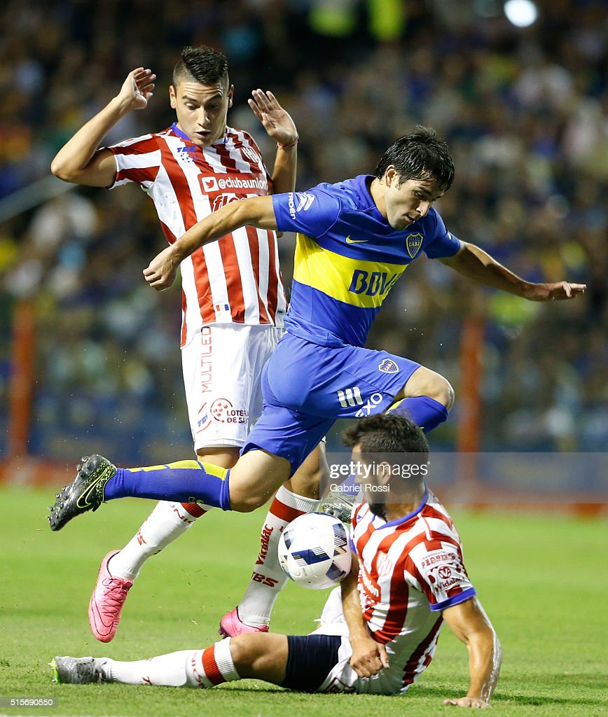 Nicolas Lodeiro of Boca Juniors fights for the ball with Jonathan Fleita of Union during a match between Boca Juniors and Union as part of Torneo de...