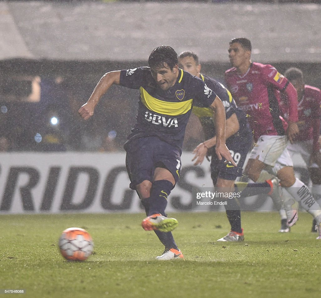 Nicolas Lodeiro of Boca Juniors kicks the ball from the penalty spot during a second leg match between Boca Juniors and Independiente del Valle as...