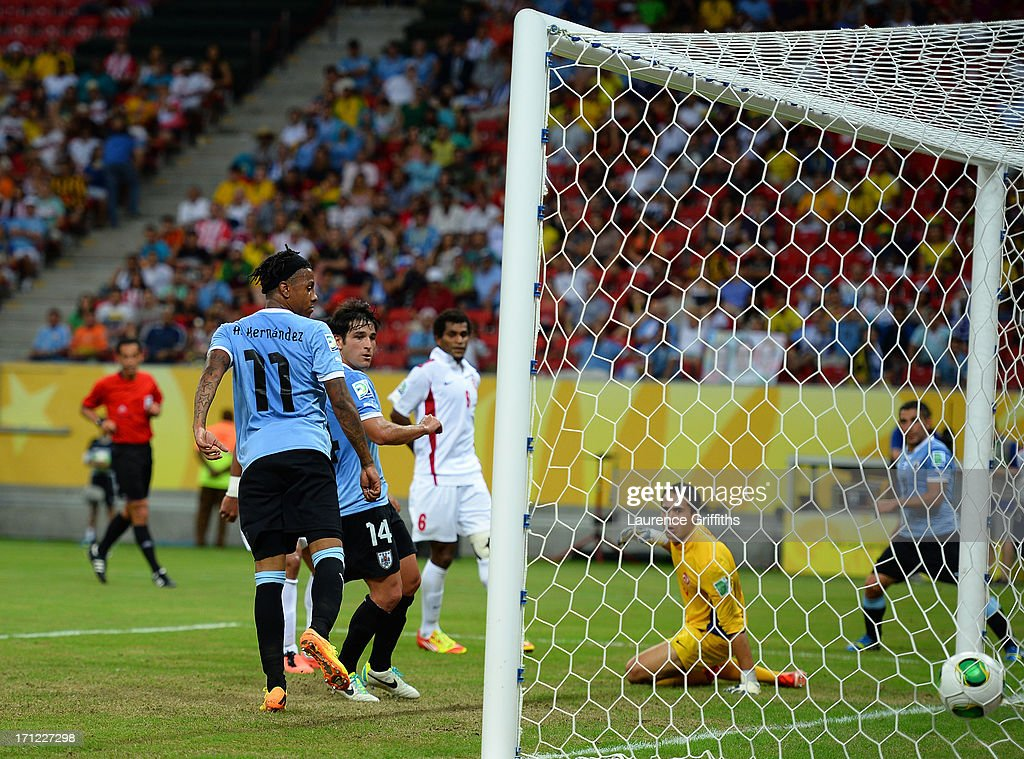 Nicolas Lodeiro of Uruguay scores a goal in the 61st minute against Gilbert Meriel of Tahiti during the FIFA Confederations Cup Brazil 2013 Group B match between Uruguay and Tahiti at Arena Pernambuco on June 22, 2013 in Recife, Brazil.
