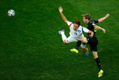 Nicolas Lombaerts of Belgium challenges Kim ShinWook of South Korea during the 2014 FIFA World Cup Brazil Group H match between South Korea and...