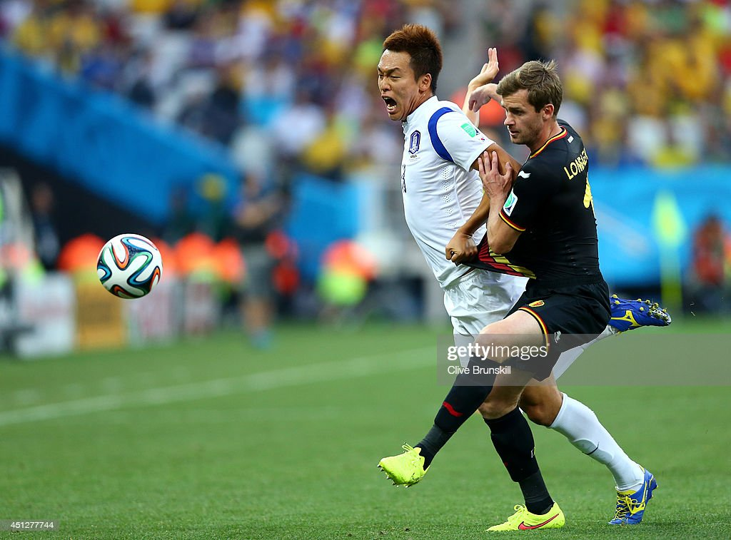 Nicolas Lombaerts of Belgium challenges Kim Shin-Wook of South Korea during the 2014 FIFA World Cup Brazil Group H match between South Korea and Belgium at Arena de Sao Paulo on June 26, 2014 in Sao Paulo, Brazil.