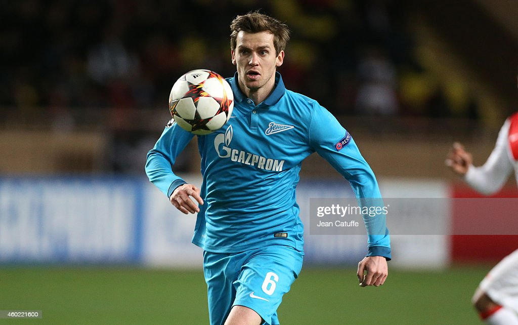 <a gi-track='captionPersonalityLinkClicked' href=/galleries/search?phrase=Nicolas+Lombaerts&family=editorial&specificpeople=4332055 ng-click='$event.stopPropagation()'>Nicolas Lombaerts</a> of FC Zenit in action during the UEFA Champions League Group C match between AS Monaco FC and FC Zenit Saint-Petersburg at Stade Louis II on December 9, 2014 in Monaco.