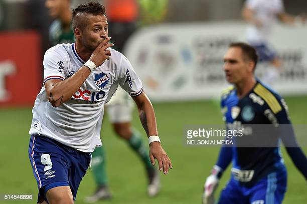 Nicolas Lopez of Uruguay's Nacional celebrates after scoring against Brazil's Palmeiras during their 2016 Copa Libertadores football match held at...