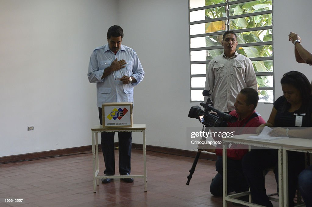 Nicolas Maduro, candidate of PSUV votes on April 14, 2013 in Caracas, Venezuela.