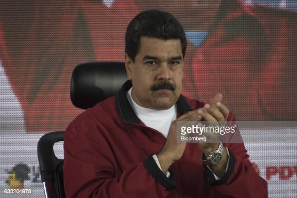 Nicolas Maduro president of Venezuela applauds during a swearing in ceremony for the new board of directors of Petroleos de Venezuela SA Venezuela's...
