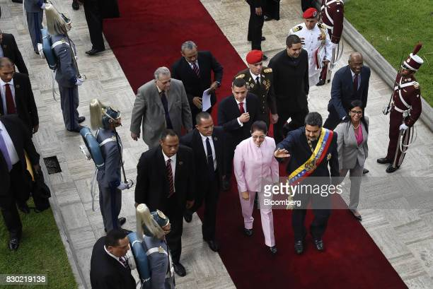 Nicolas Maduro president of Venezuela center right waves while arriving to the National Assembly building with Cilia Flores First Lady of Venezuela...