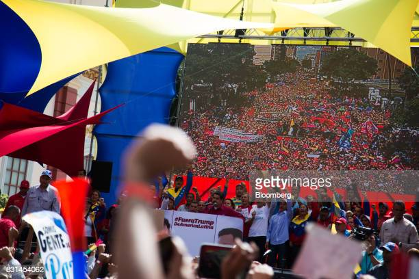 Nicolas Maduro president of Venezuela center speaks during a progovernment rally against US President Donald Trump in Caracas Venezuela on Monday Aug...