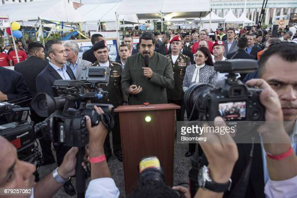 Nicolas Maduro president of Venezuela center speaks during an event in Caracas Venezuela on Thursday May 4 2017 The South American nation has been...