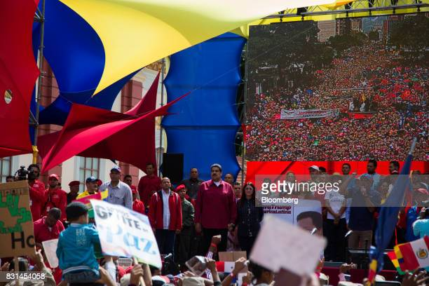 Nicolas Maduro president of Venezuela center stands during a progovernment rally against US President Donald Trump in Caracas Venezuela on Monday Aug...