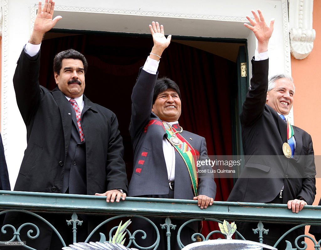 Nicolas Maduro, President of Venezuela, <a gi-track='captionPersonalityLinkClicked' href=/galleries/search?phrase=Evo+Morales&family=editorial&specificpeople=272981 ng-click='$event.stopPropagation()'>Evo Morales</a>, President of Bolivia, and Álvaro García Linera, Vice-President of Bolivia greet the people from a balcony of the Quemado Presidential Palace after the swearing in ceremony for the third term on January 22, 2015 in La Paz, Bolivia.