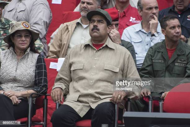 Nicolas Maduro president of Venezuela sits during a ceremony with Militia members in Caracas Venezuela on Monday April 17 2017 Maduro approved a plan...