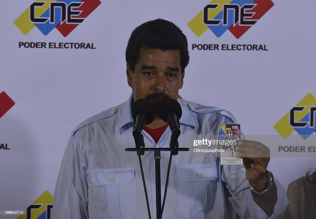 Nicolas Maduro talks with the media after voting in venezuelan presidential elections. Maduro, political heir of the late Venezuelan President Hugo Chavez, competes with opposition candidate Henrique Capriles.