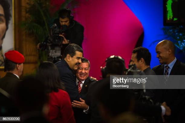 Nicolas Maduro Venezuela's president center left embraces Henry Rangel Silva United Solcialist Party of Venezuela member and reelected governor of...