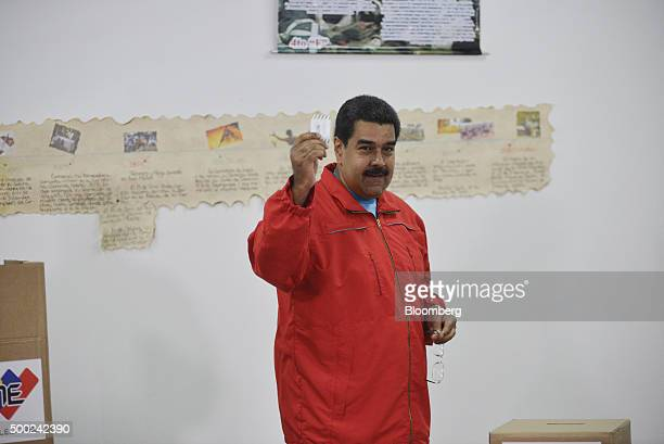 Nicolas Maduro Venezuela's president displays his ballot slip before casting it into a ballot box during the national congressional elections in...
