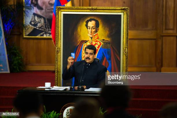 Nicolas Maduro Venezuela's president holds the constitution during a press conference at the Miraflores Palace in Caracas Venezuela on Tuesday Oct 17...
