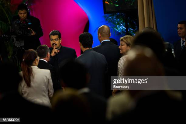 Nicolas Maduro Venezuela's president left gestures while arriving ahead of a press conference at the Miraflores Palace in Caracas Venezuela on...