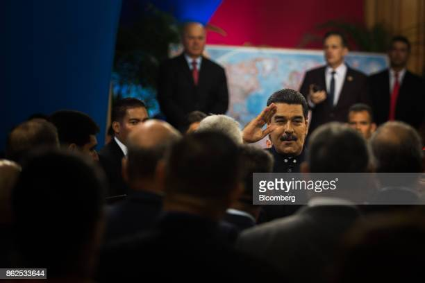 Nicolas Maduro Venezuela's president right gestures while arriving ahead of a press conference at the Miraflores Palace in Caracas Venezuela on...