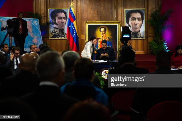 Nicolas Maduro Venezuela's president right speaks with his wife Cilia Flores during a press conference at the Miraflores Palace in Caracas Venezuela...
