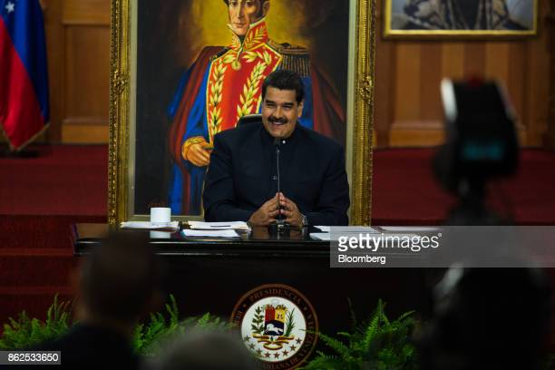 Nicolas Maduro Venezuela's president smiles during a press conference at the Miraflores Palace in Caracas Venezuela on Tuesday Oct 17 2017 In his...