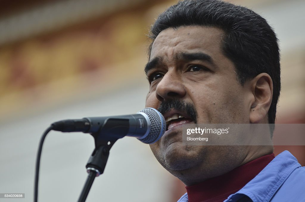 Nicolas Maduro, Venezuela's president, speaks during a rally for women and peace at the Miraflores Palace in Caracas, Venezuela on Tuesday, May 24, 2016. On Tuesday, hundreds of women took to the streets in a show of support for President Maduro and against what they called the violent demonstrations by the opposition. Photographer: Carlos Becerra/Bloomberg via Getty Images