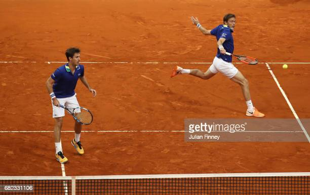 Nicolas Mahut and Edouard RogerVasselin of France in action in the doubles against Jamie Murray of Great Britain and Bruno Soares of Brazil during...