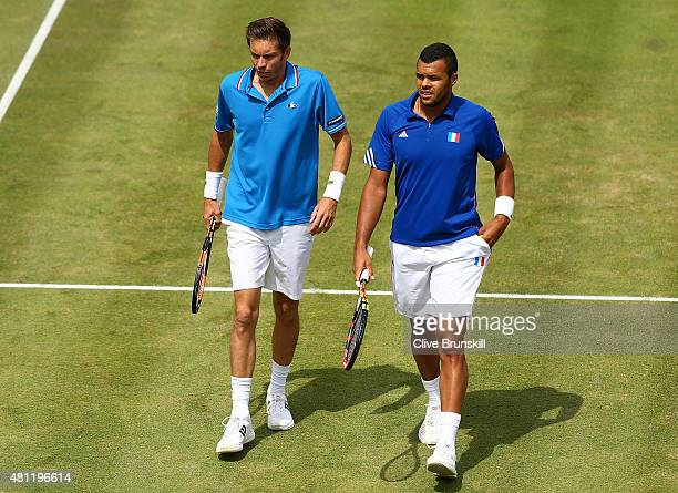 Nicolas Mahut and JoWilfried Tsonga of France in action in their match against Jamie Murray and Andy Murray of Great Britain during Day Two of the...