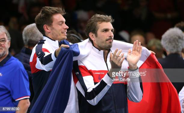Nicolas Mahut and Julien Benneteau of France celebrate winning the Davis Cup during day 3 of the Davis Cup World Group final between France and...