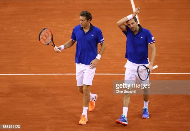 Nicolas Mahut and Julien Benneteau of France react in their doubles match against Jamie Murray and Dominic Inglot of Great Britain during the second...