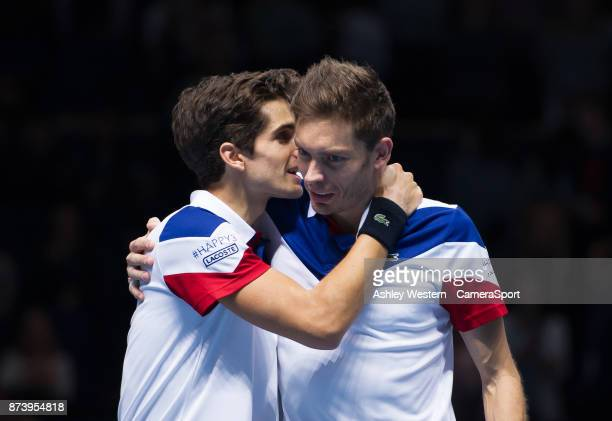 Nicolas Mahut and PierreHugues Herbert of France celebrate their victory over JeanJulien Rojer of Netherlands and Horia Tecau of Romania in their...