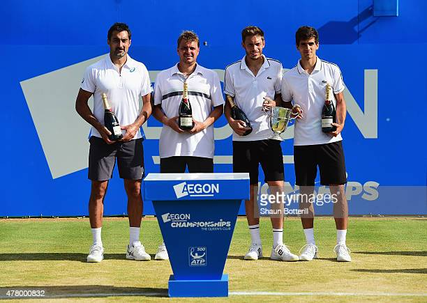 Nicolas Mahut and PierreHugues Herbert of France celebrate victory as they pose with runners up Marcin Matkowski of Poland and Nenad Zimonjic of...