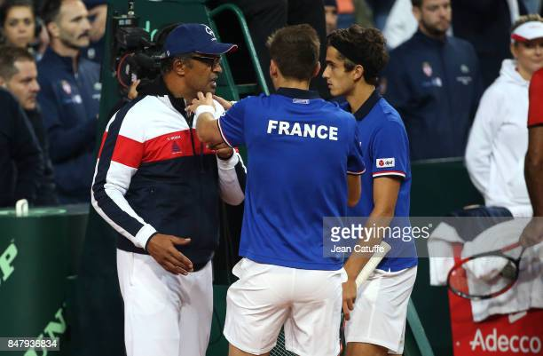 Nicolas Mahut and PierreHugues Herbert of France celebrate with captain Yannick Noah winning the doubles match against Serbia on day two of the Davis...