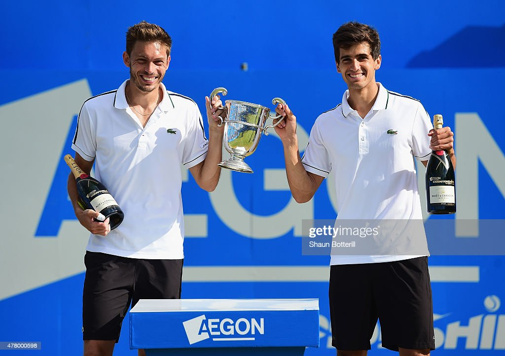 Nicolas Mahut (L) and Pierre-Hugues Herbert of France celebrate with the winners trophy after their victory against Marcin Matkowski of Poland and Nenad Zimonjic of Serbia in the men's doubles final during day seven of the Aegon Championships at Queen's Club on June 21, 2015 in London, England.